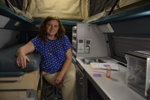 Nurse practitioner Kathy Hefner inside the Vecinos van