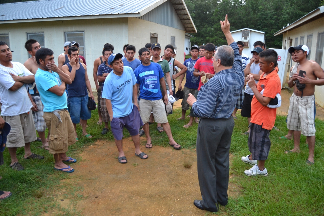 Father Tony briefing farmworkers on pending immigration reform in the summer of 2013